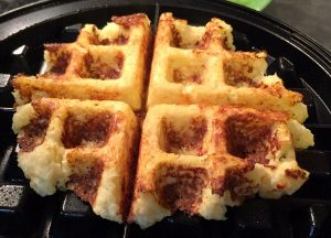 low-carb-cauliflower-waffle-roll-on-iron