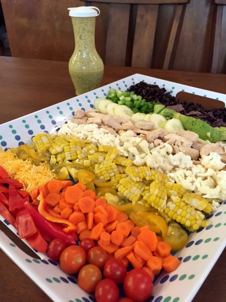 rainbow-salad-toppings-with-dressing