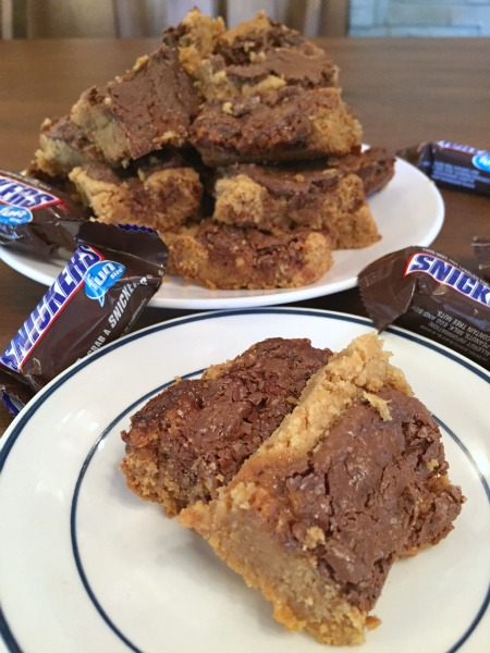 peanut-butter-cookie-snickers-bars-piled-up