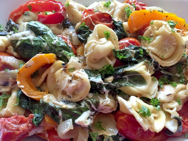 Roasted Vegetable Tortellini Bake -- A cheesy & delicious baked tortellini Meatless Monday Meal! Full of cheese and roasted veggies for a filling & flavorful vegetarian dinner idea.