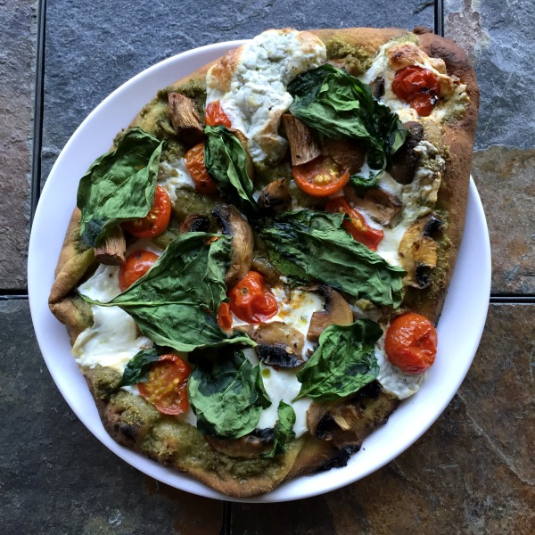 plate of naan pesto pizza