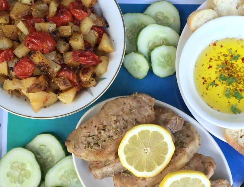 lemony pork chops, potatoes, and tomatoes