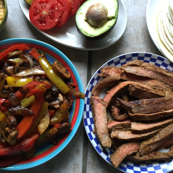 Easy steak fajitas with onions, pepper, and mushrooms -- Gluten free (use GF tortillas) and low carb (use a low carb wrap)!
