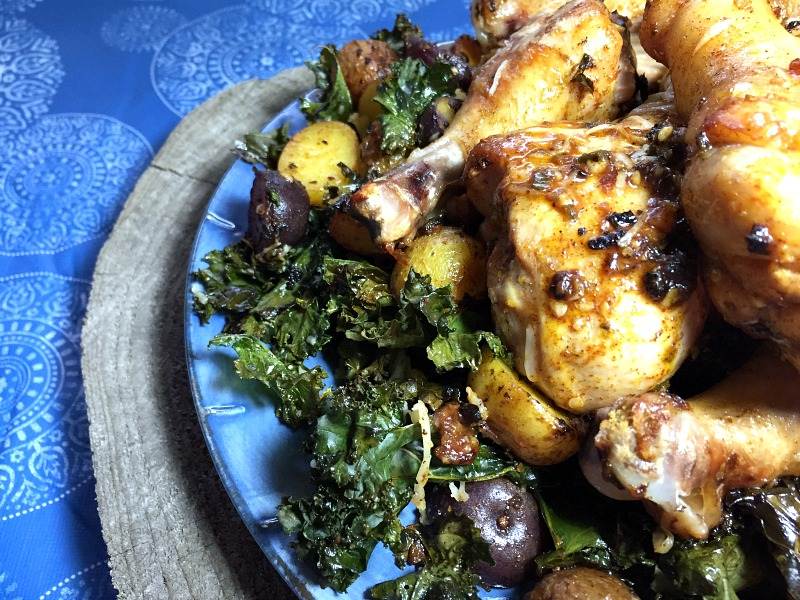 Sheet Pan Chili-Lime Chicken Drumsticks with Baby Potatoes and Crispy Kale -- A flavorful one pan meal! Naturally gluten free.