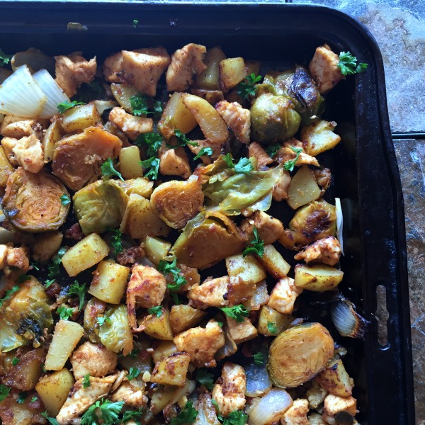 This Sheet Pan Chicken Dinner with Roasted Brussels Sprouts and Potatoes is naturally gluten free and full of roasted veggie flavor!