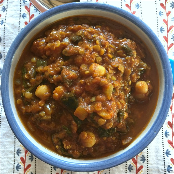 This simple slow cooker vegetarian chickpea lentil stew is a warm and welcoming choice for a chilly winter's night: The perfect vegan comfort food! Serve over pasta, potatoes, rice, or quinoa for a complete meal.