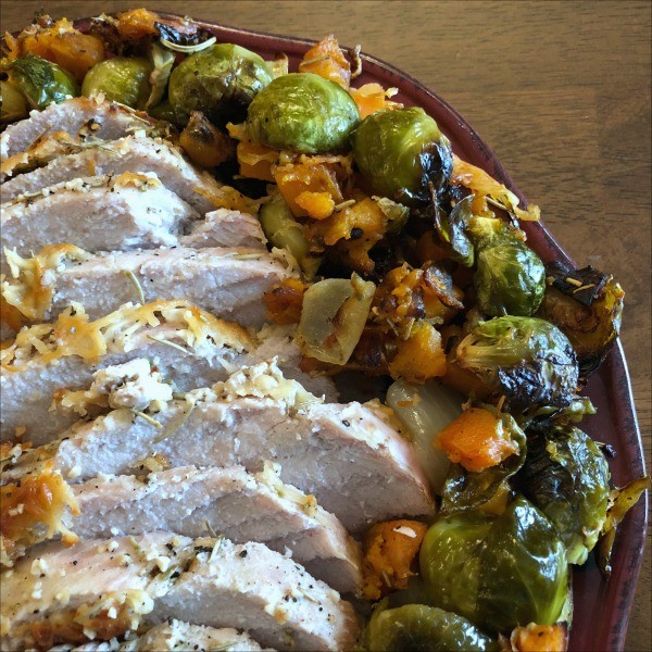 Parmesan Pork Roast with Brussels Sprouts & Sweet Potato has it all: In this gluten free one pan Sunday dinner recipe, the nicely browned sprouts get an additional shot of flavor from the salty Parmesan -- and contrast nicely with the sweet potatoes and juicy pork.