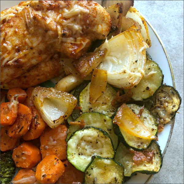 Need an easy sheet pan chicken tenders recipe? Sheet pan smoky Parmesan chicken tenders & veggies are naturally gluten free, and everything here but the carrots is low carb. And, everything in this easy sheet pan dinner recipe is smoky good — while roasting the vegetables brings out their natural sweetness, in a lovely contrast to the smoked paprika and salty Parmesan.