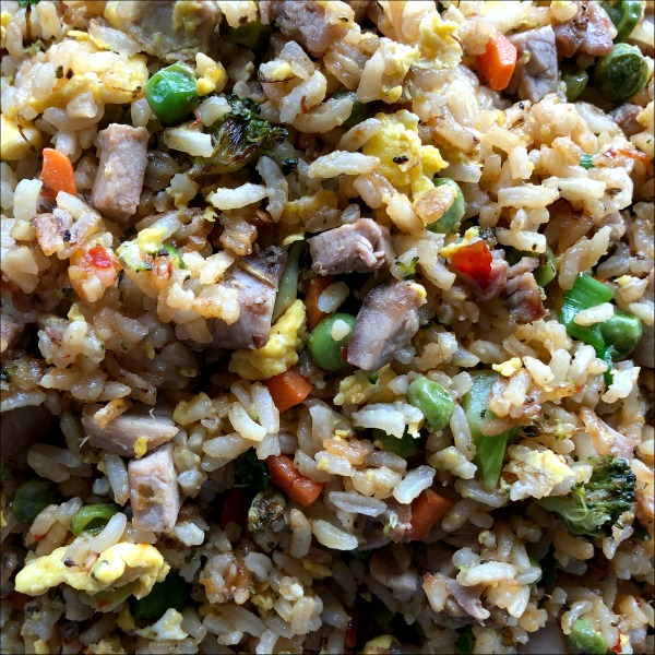 Fried rice is one of my favorite ways to use up leftovers and give new life to leftover rice, meat, or veggies. Easy Leftover Pork Fried Rice only takes about 20 minutes to throw together, so it's a great weeknight recipe for a busy evening -- cheaper than takeout!
