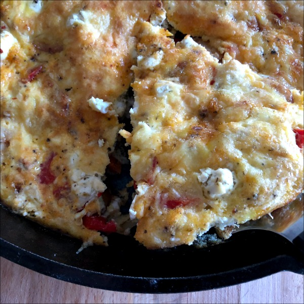 This easy weeknight frittata recipe brings in all the flavor of traditional sausage, peppers, and onions, but packs an extra wallop of flavor from the garlicky goat cheese -- plus you get to enjoy the contrasting of the creamy eggs and just a little salty tang from the Parmesan topping. Naturally gluten free, low carb.