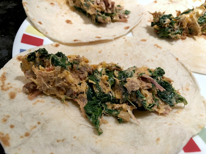 Salsa Verde Pork & Spinach Baked Taquitos are an irresistibly easy 30 minute weeknight dinner recipe. Try these the next time you have some leftover salsa verde pork (or leftover carnitas, or leftover pork taco meat, or...).