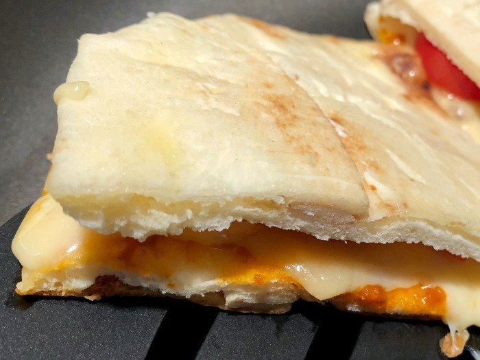 flipping naan grilled cheese