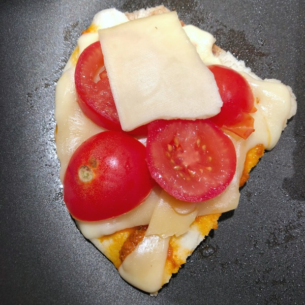 assembling naan grilled cheese
