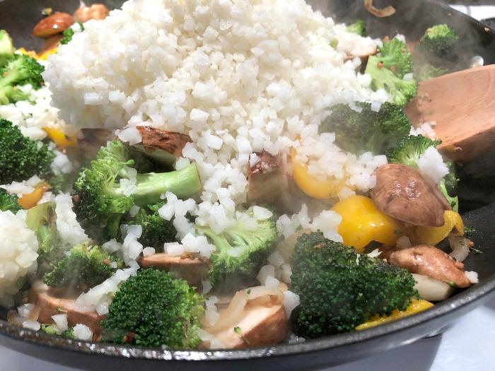 add riced cauliflower to a stir fry