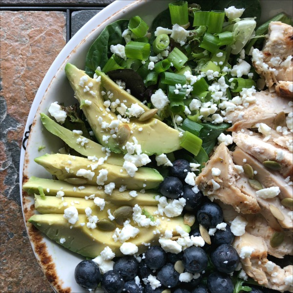 salad with avocado blueberries and chicken