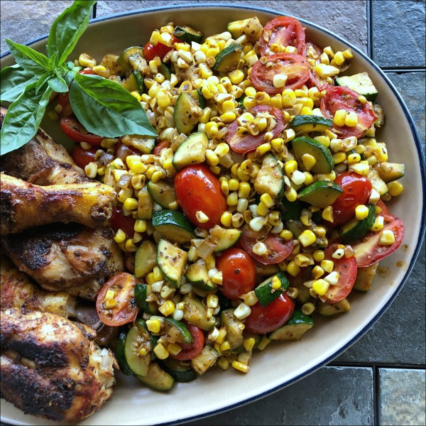 skillet chicken drumsticks with corn zucchini and tomatoes