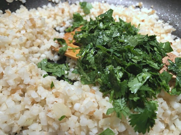 add cilantro to cauliflower rice