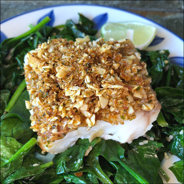 plate of baked low carb cod with spinach