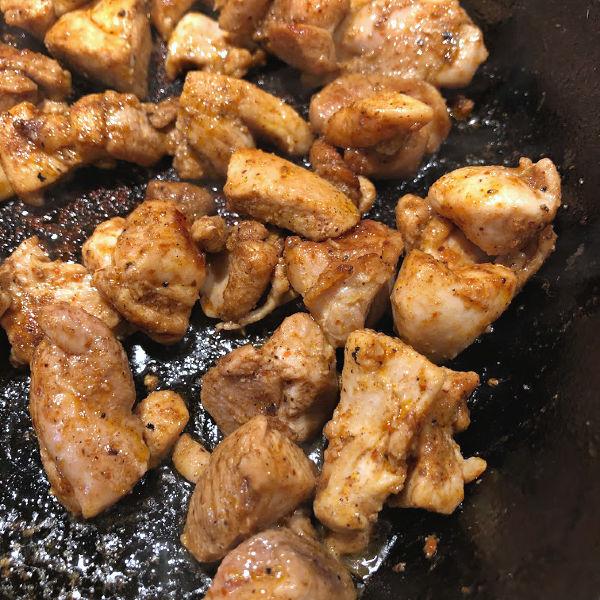 seasoned chicken in a skillet