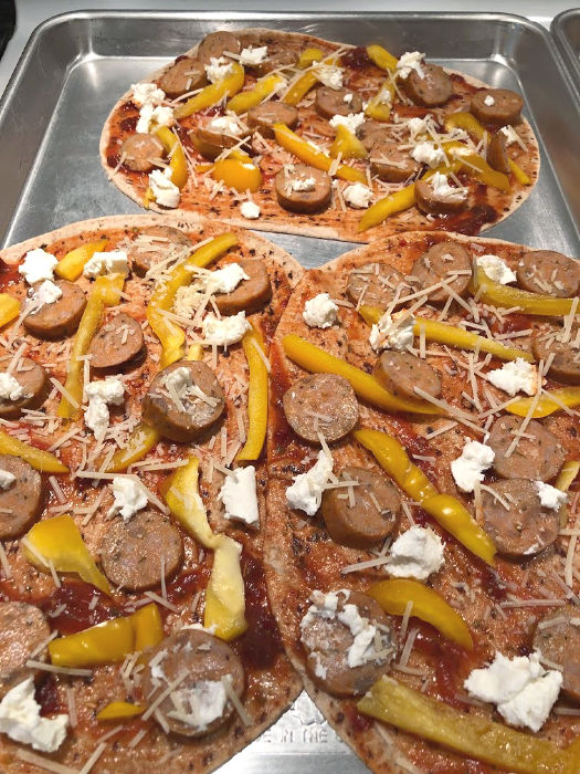 flatbread pizzas on a baking sheet