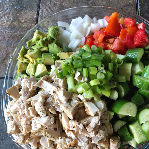 assembling the chopped chicken and veggie salad