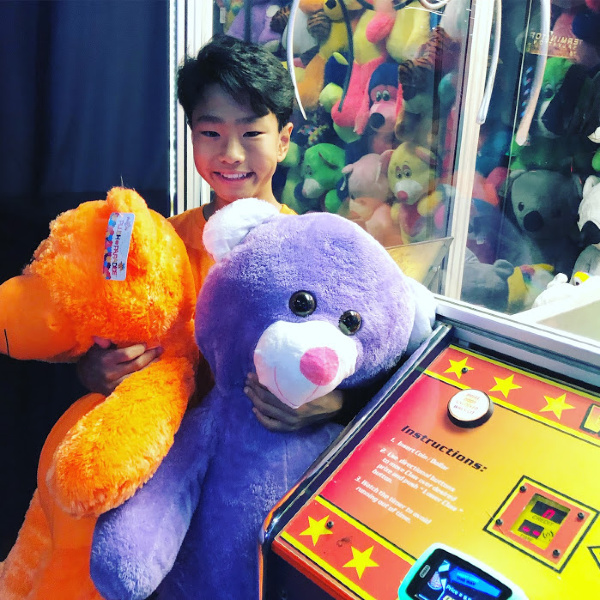 two giant bears from the claw machine at dave & busters