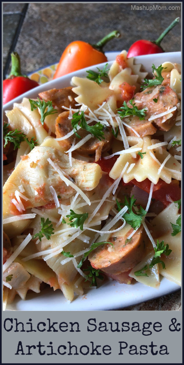 Easy weeknight chicken sausage and artichoke pasta with Parmesan cheese and tomatoes