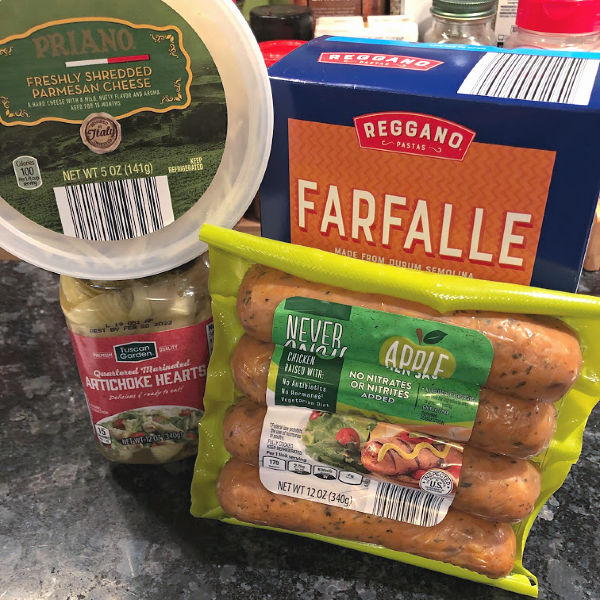 ALDI chicken sausage, parmesan cheese, artichoke hearts, and box of pasta