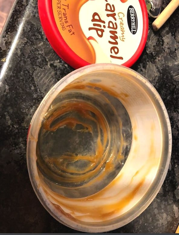 empty container of caramel dip