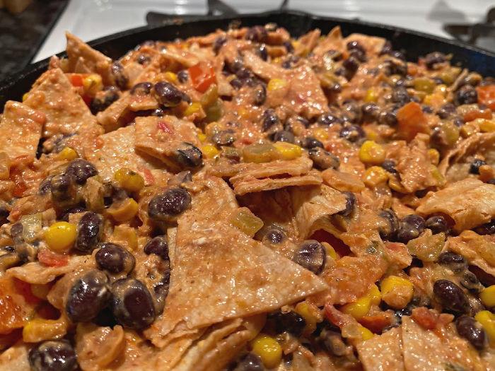 mix torn corn tortillas into the vegetarian enchiladas skillet