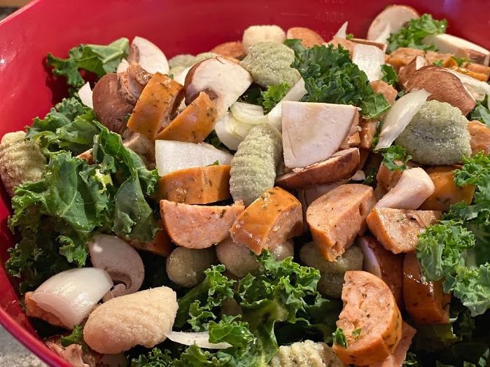 bowl full of sausage veggies and gnocchi
