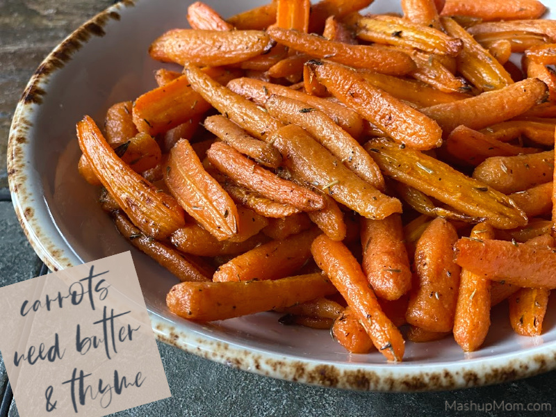 A dish of roasted carrots seasoned with butter and thyme