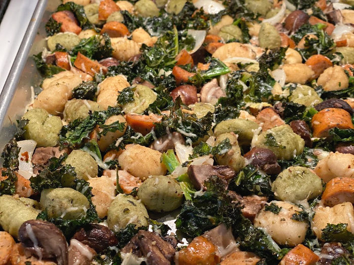 Sheet pan of roasted gnocchi with sausage kale and mushrooms
