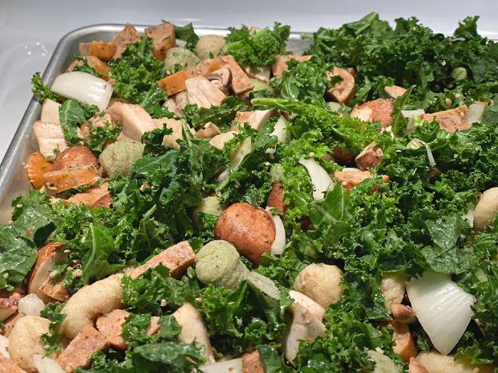 sheet pan of kale, sausage, mushrooms, and gnocchi