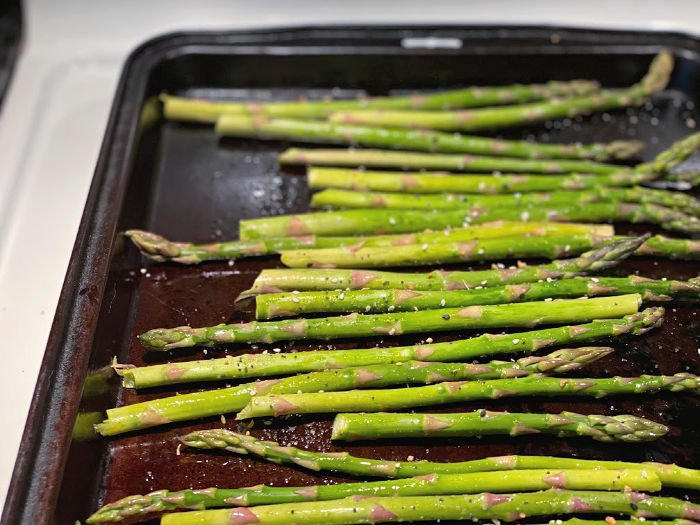 seasoned asparagus on the sheet pan