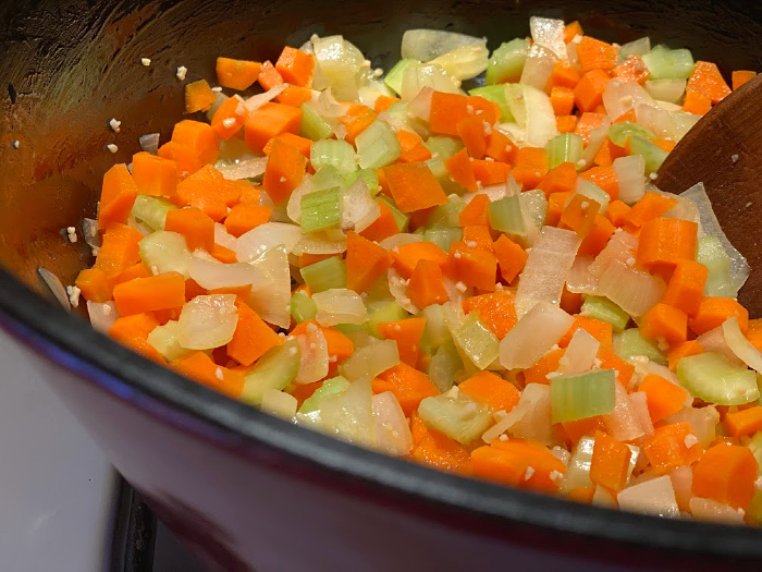 carrots, celery, onion, and garlic cooking up in a soup pot