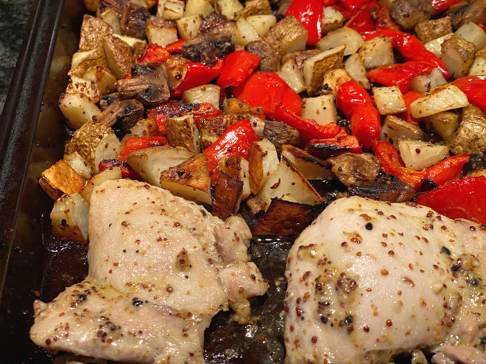 roasted chicken and vegetables on the pan