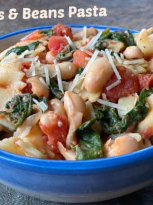 This 25 minute vegetarian Bowties & Beans Pasta recipe with white beans, spinach, and tomatoes comes together quickly on a busy weeknight, using mostly pantry staples! Flavorful & filling for your Meatless Monday.