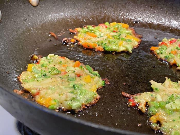 Fry Korean vegetable pancakes in a skillet