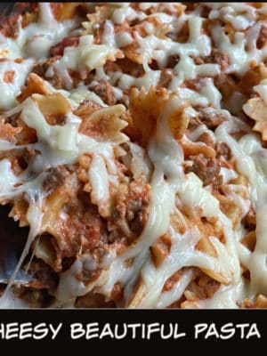 Easy Cheesy Beautiful Pasta Skillet — Yes, it's earned all of these adjectives, and then some! Why? Well, this hearty weeknight dinner recipe packs all of the taste of lasagna into a super easy, super kid-pleasing, 30 minute meal; it's the perfect comfort food for a busy weeknight.