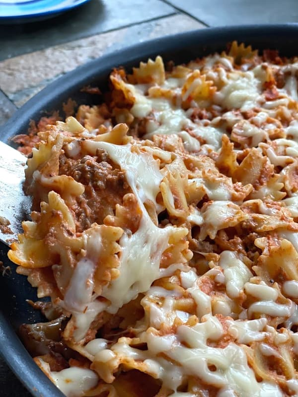 Serving the cheesy pasta skillet