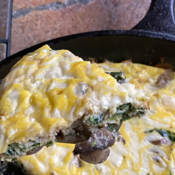 serving slices of spinach mushroom frittata