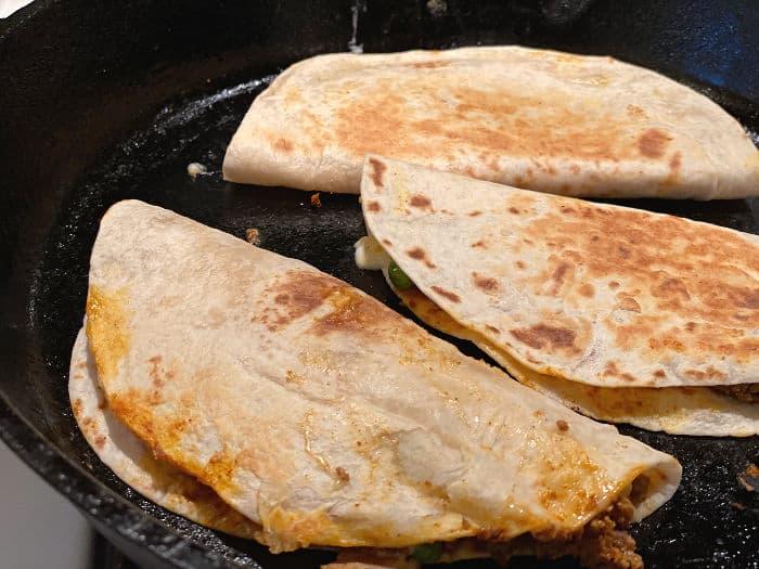 brown the quesadillas in the pan