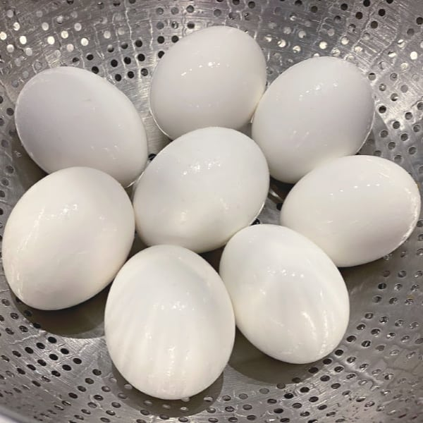 cool eggs under running water