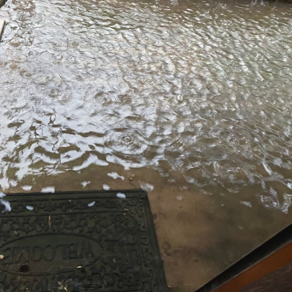 rain flooding a patio