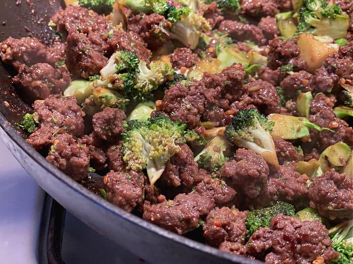 beef and broccoli stir fry in skillet