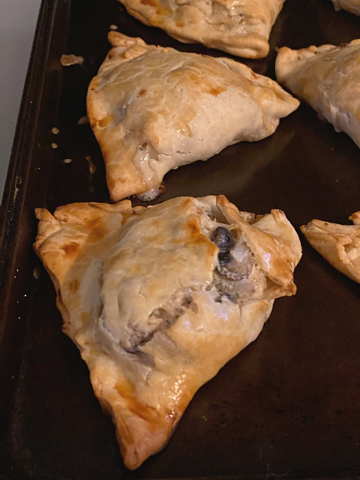 browned hand pies on baking sheet