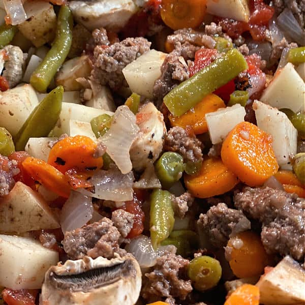 stir veggies into the beef