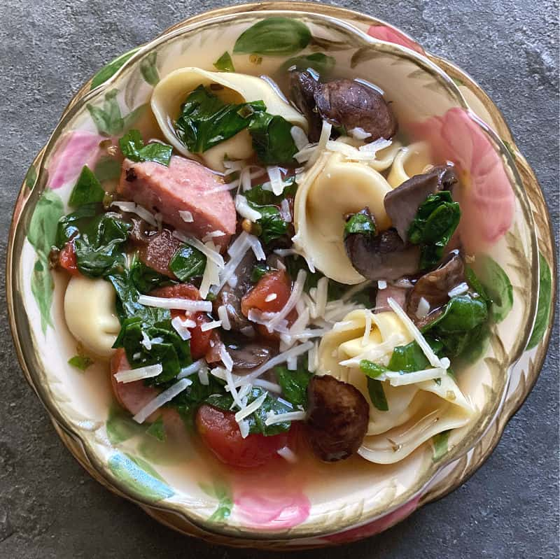Bowl of kielbasa tortellini soup, done in 30 minutes!