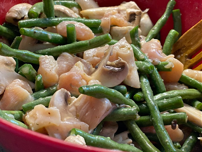 toss chicken and veggies in dressing